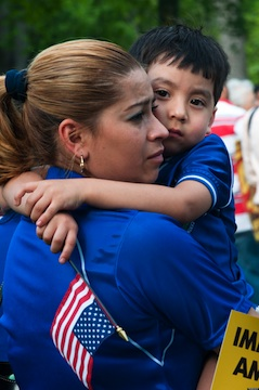 Latina mother holding son
